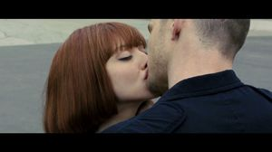 Justin Timberlake and Amanda Seyfried kiss. In Time