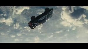 Roman gets dragged out of plane in Furious 7 flying cars clip