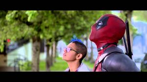 Deadpool rescues a cat in a tree in latest promo clip